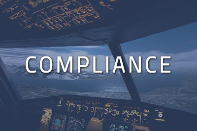 "Photo of a cockpit with ""Compliance"" written over it"