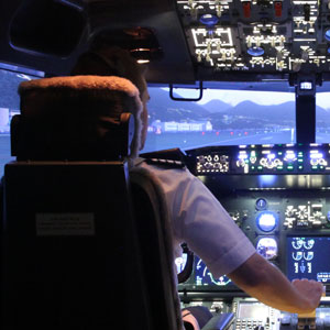 Pilot in cockpit who is flying a plane using ProSim's simulation software