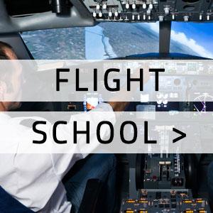 "Flight cockpit simulator with ""Flight school"" written over it"