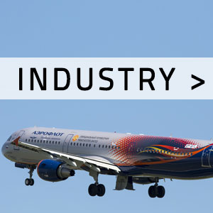 "Airplane in the air with ""Industry"" written over it"