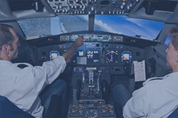 Two pilots in a flight simulator going through the checklist before take off