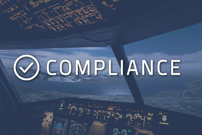 """Photo of a cockpit with """"Compliance"""" written over it"""